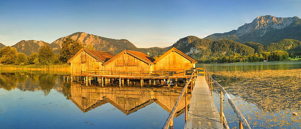 Boathouses at Kochelsee Lake at sunset, Herzogstand and Heimgarten Mountains, Upper Bavaria, Bavaria, Germany - 1160-3947