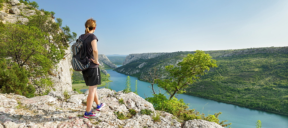Hiker at a viewing point over Krka River, Krka National Park, Dalmatia, Croatia, Europe
