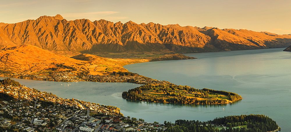 View over Queenstown and Lake Wakatipu to The Remarkables Mountains at sunset, Otago, South Island, New Zealand, Pacific