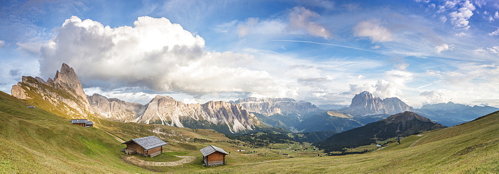 Panorama of green meadows and huts of the Odle mountain range seen from Seceda Val Gardena Trentino Alto Adige Italy Europe