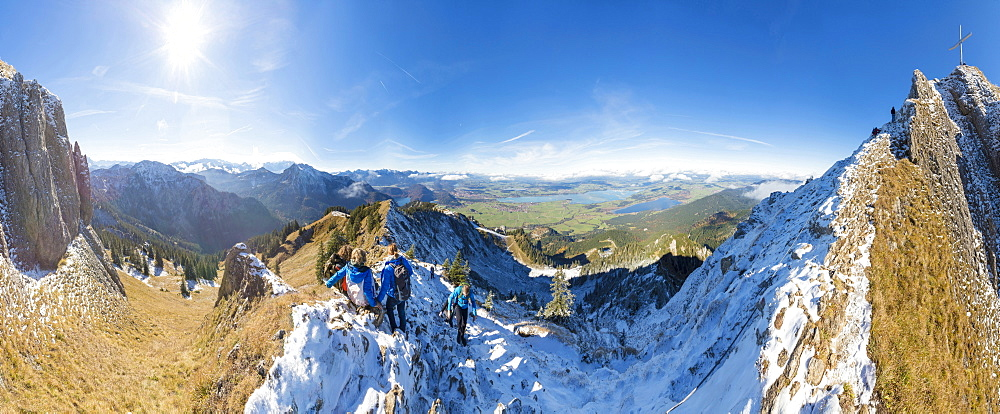 Climbers on steep crest covered with snow in the Ammergau Alps, Tegelberg, Fussen, Bavaria, Germany, Europe