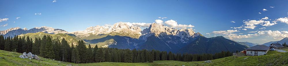 Panorama of meadows and hut framed by peaks, Malga Ritorto, Madonna di Campiglio, Brenta Dolomites, Trentino-Alto Adige, Italy, Europe
