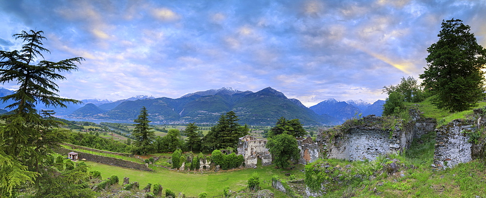 Panorama of ancient ruins of Fort Fuentes framed by green hills at dawn, Colico, Lecco province, Valtellina, Lombardy, Italy, Europe - 1179-2287