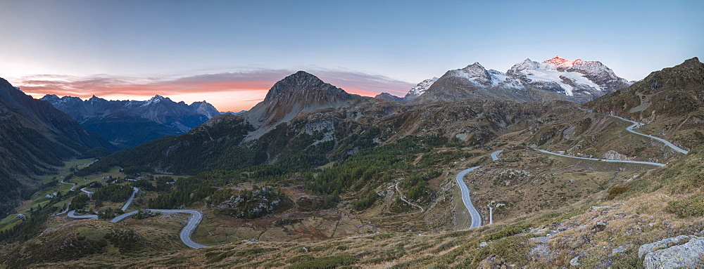 Panoramic of the road bends of Bernina Pass at dawn, Poschiavo Valley, canton of Graubünden, Engadine, Switzerland
