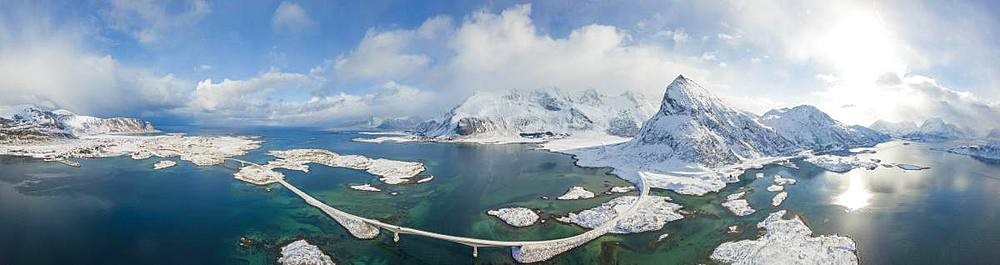 Aerial panoramic view of snowy peak of Volanstinden and Fredvang bridge, Lofoten Islands, Nordland, Norway, Europe - 1179-3347