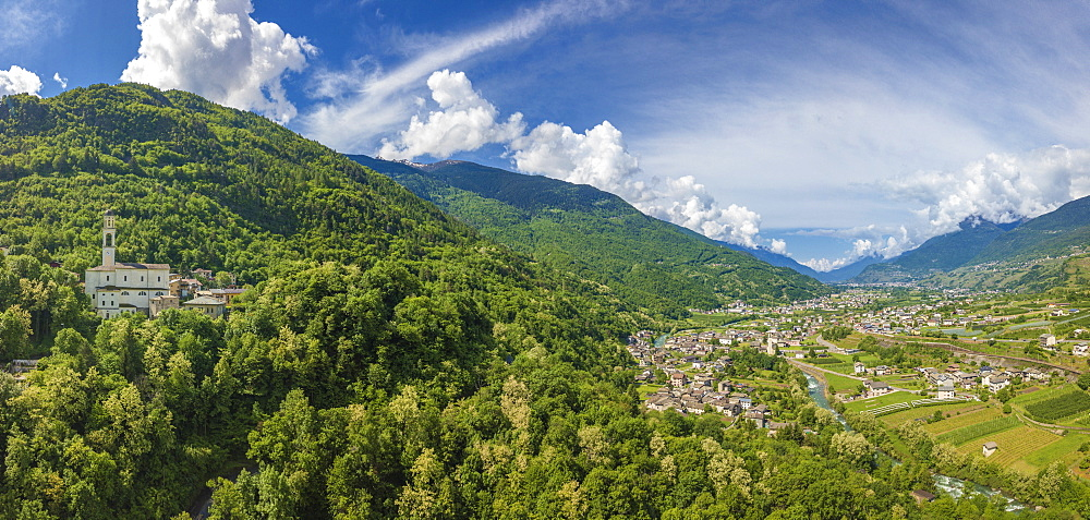 Aerial view of church and green hills around Sazzo, Ponte In Valtellina, Sondrio province, Lombardy, Italy, Europe