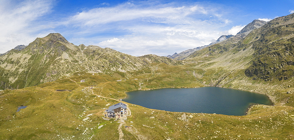 Aerial panoramic of Lake Emet, Rifugio Bertacchi and peak Emet, Spluga Valley, Sondrio province, Valtellina, Lombardy, Italy, Europe