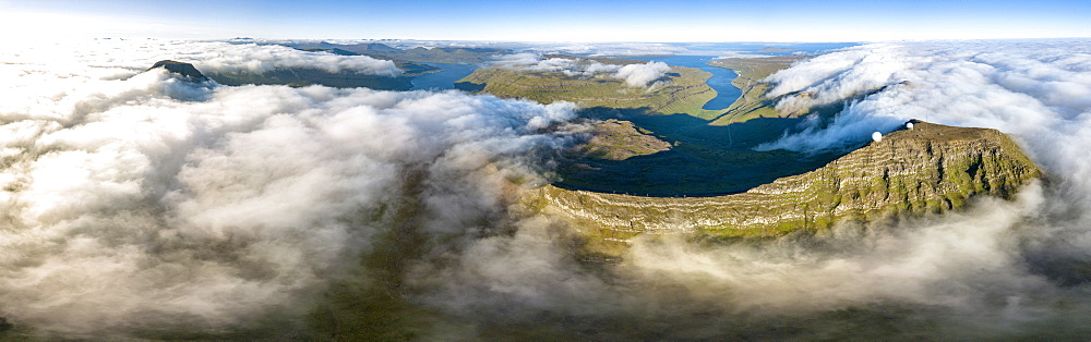 Aerial panoramic of Skælingsfjall mountain and radar station on Sornfelli peak, Streymoy island, Faroe Islands, Denmark