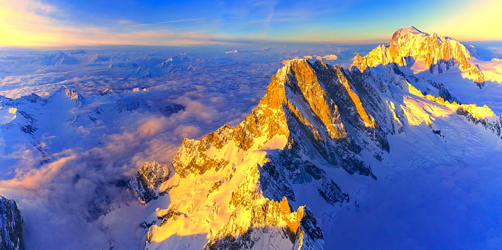 Aerial panoramic of Grandes Jorasses, Petites Jorasses and Mont Blanc at sunrise, Courmayeur, Aosta Valley, Italy