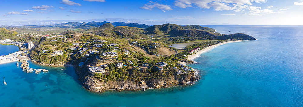 Aerial panoramic by drone of Caribbean Sea surrounding Deep Bay and Galley Bay, Antigua, Leeward Islands, West Indies, Caribbean, Central America