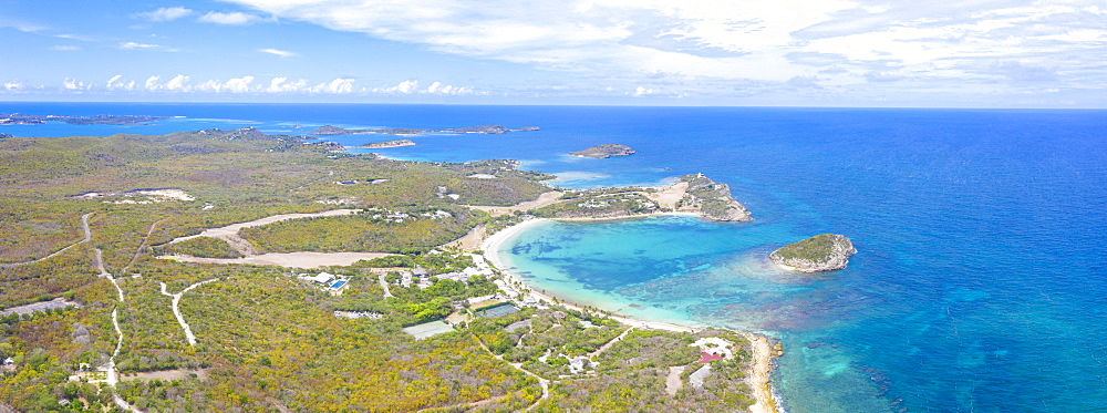 Aerial panoramic by drone of Caribbean Sea surrounding Exchange Bay, Antigua, Leeward Islands, West Indies, Caribbean, Central America