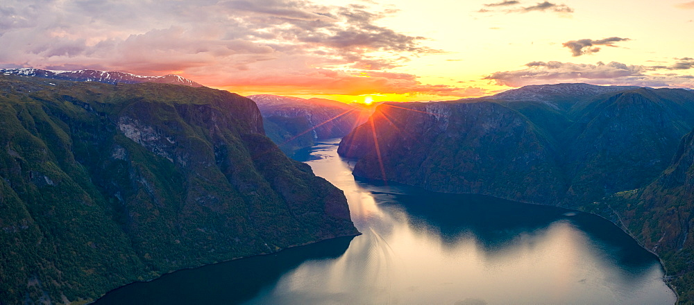 Aerial panoramic of dramatic sky at sunset along the fjord from Stegastein lookout, Aurlandsfjord, Sogn og Fjordane county, Norway (drone)