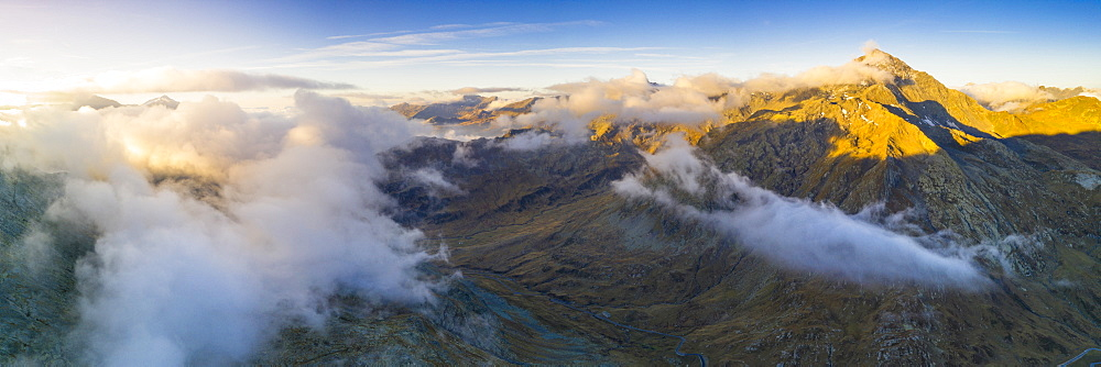 Aerial panoramic of sea of clouds over Pizzo Tambo and bends of the Spluga Pass road, Valle Spluga, Valtellina, Lombardy, Italy, Europe - 1179-4035