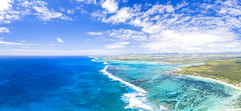 Aerial panoramic of waves of Indian Ocean and turquoise coral reef, Poste Lafayette, East coast, Mauritius (drone)