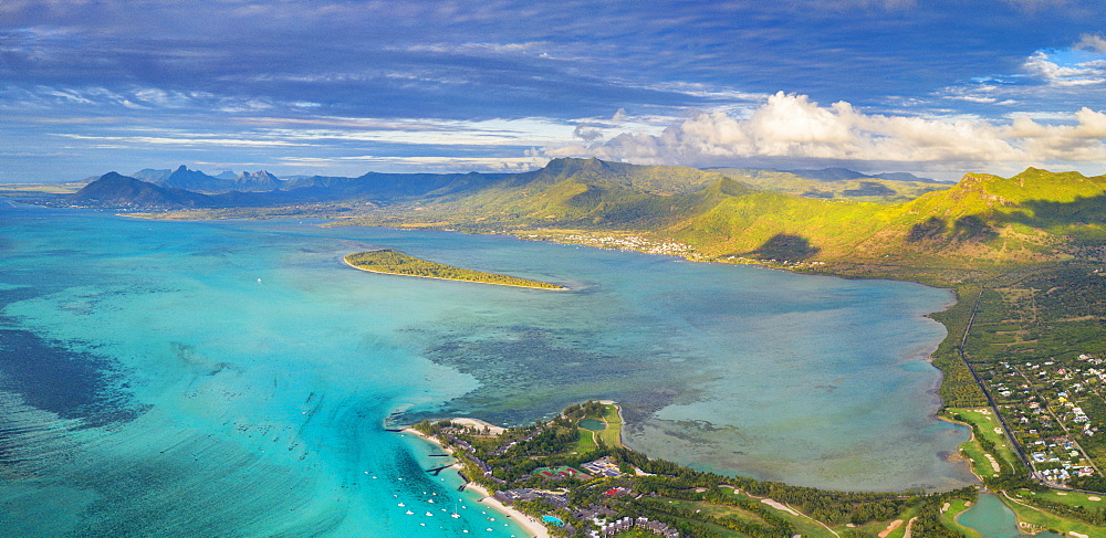 Aerial panoramic of turquoise lagoon surrounding Aux Benitiers and La Gaulette, Le Morne Brabant, Mauritius, Indian Ocean, Africa