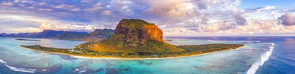 Aerial panoramic of Le Morne Brabant peninsula and turquoise coral reef at sunset, Black River, Mauritius, Indian Ocean, Africa