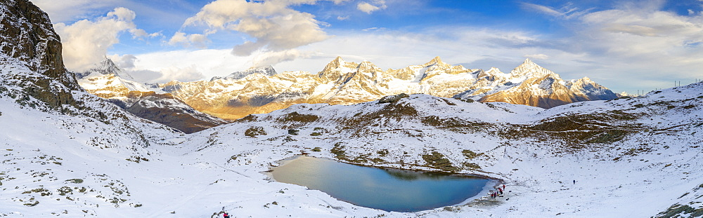 Aerial panoramic of Riffelsee lake surrounded by snow, Zermatt, canton of Valais, Swiss Alps, Switzerland, Europe
