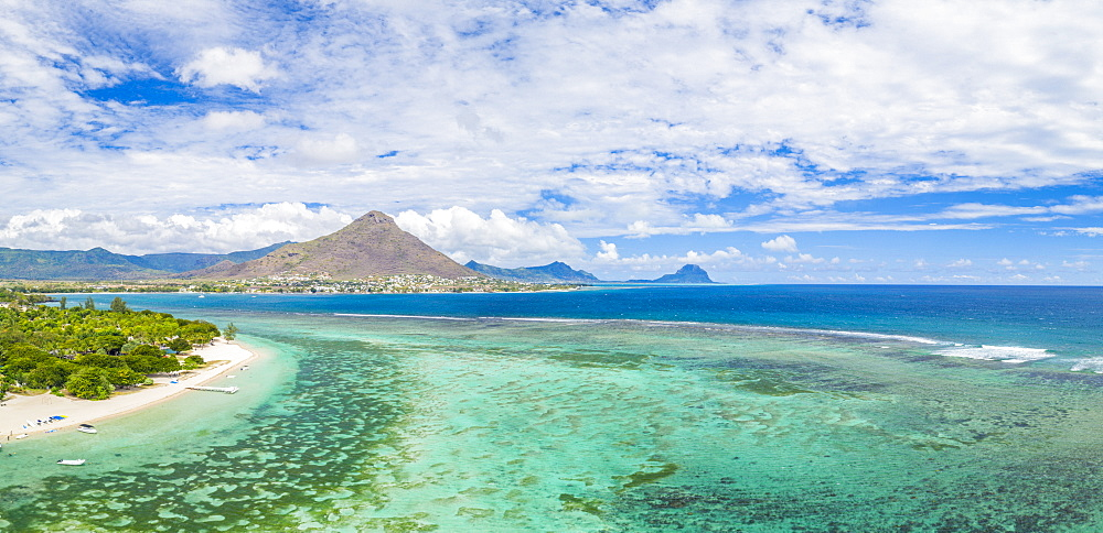 Aerial panoramic by drone of Flic en Flac beach with Tamaris village and Le Morne mountain, Black River, Mauritius, Indian Ocean, Africa