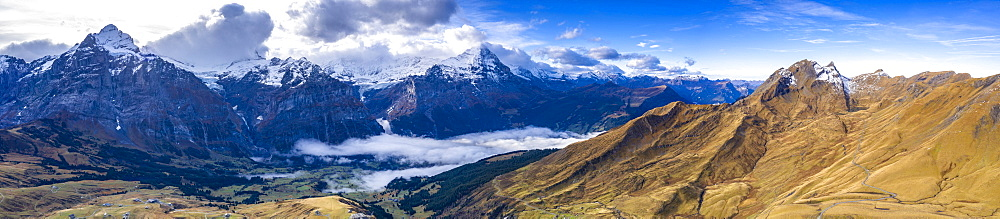 Aerial panoramic of Eiger and Schreckhorn in autumn from First and Grindelwald, Bernese Alps, Canton of Bern, Switzerland, Europe