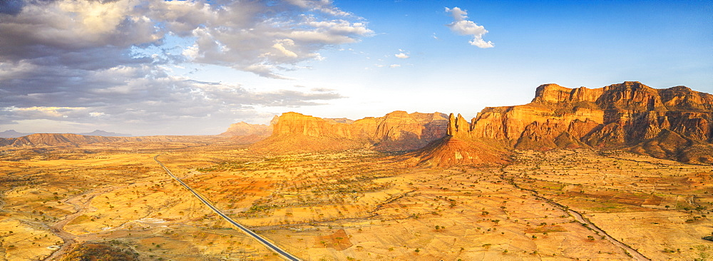 Aerial panoramic of road at feet of Gheralta Mountains canyons, Hawzen, Tigray Region, Ethiopia, Africa (drone)