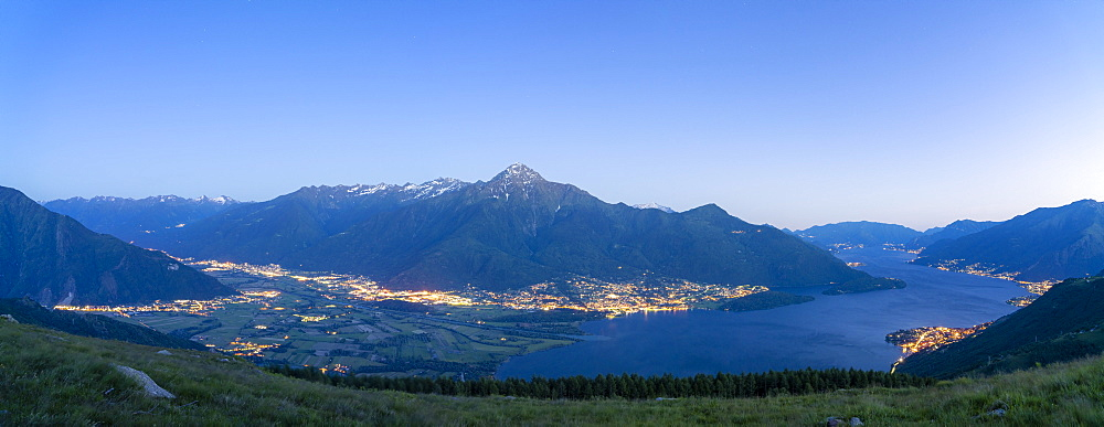 Panoramic of dusk over Lake Como, Alto Lario and lower Valtellina, Lombardy, Italy