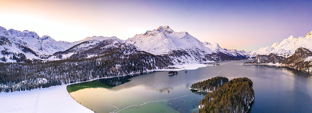 Panoramic of Piz Da La Margna and Lake Sils during a winter sunrise, aerial view, Engadin, canton of Graubunden, Switzerland