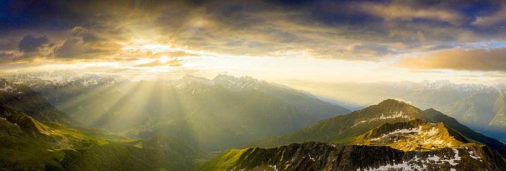 Aerial panoramic of Bernina mountain range and Pizzo Scalino lit by sunrise, Valmalenco, Valtellina, Lombardy, Italy, Europe