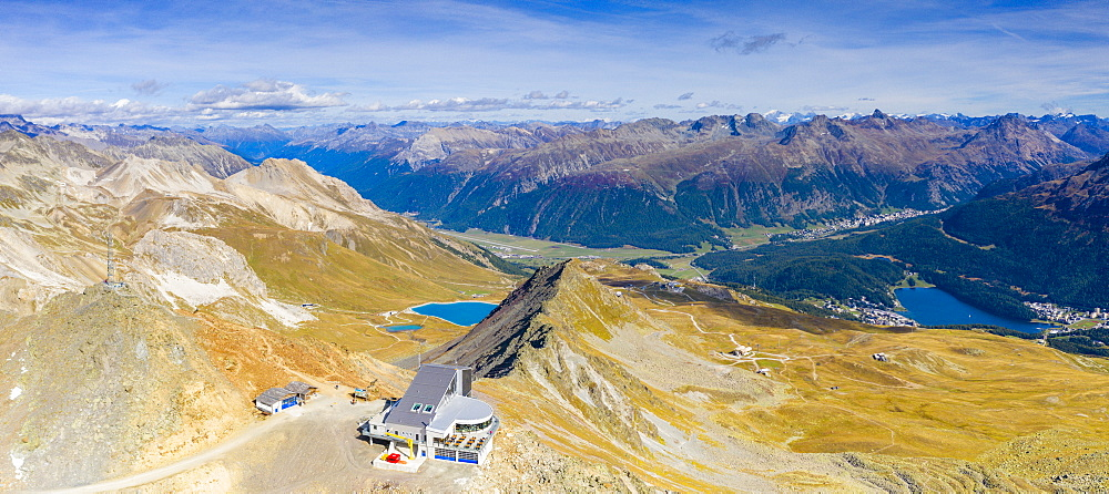 Aerial panoramic view of Piz Nair, Lej Alv lake and St.Moritz on background, Engadine, canton of Graubunden, Switzerland (drone)