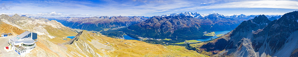 Aerial panoramic of Piz Nair with lakes of St. Moritz and Silvaplana in the background, Engadine, Graubunden, Switzerland (drone