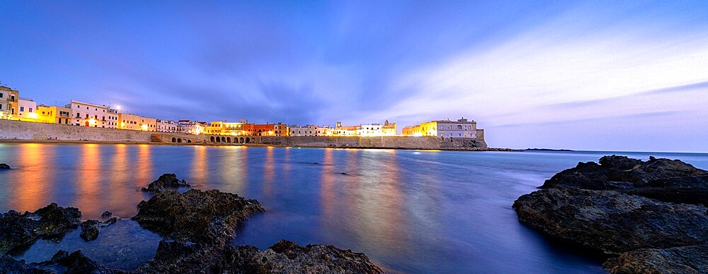 Clouds over Gallipoli washed by the Ionic Sea at dusk, Lecce province, Salento, Apulia, Italy, Europe - 1179-4975