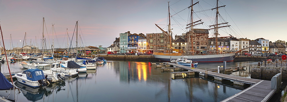 Dusk over Sutton Harbour and the Barbican, the historic and tourist heart of the city of Plymouth, Devon, England, United Kingdom, Europe