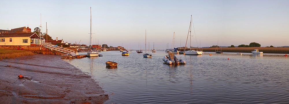 A warm view at sunset, at low tide on the estuary of the River Exe, at Topsham, Devon, England, United Kingdom, Europe