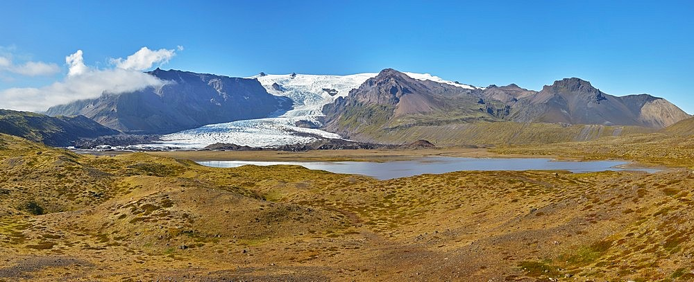 A retreating glacier, pouring down from the Vatnajokull icecap, in Skaftafell National Park, southern Iceland, Polar Regions - 1202-453
