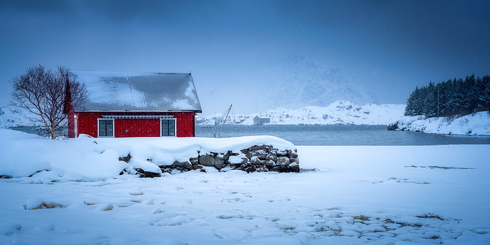 Traditional Rorbu on a snowy winter's day, Nordland, Lofoten Islands, Norway - 1216-415