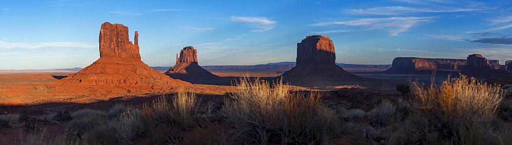 A panoramic image of the giant sandstone buttes at sunset in Monument Valley Navajo Tribal Park, Arizona, United States of America, North America - 1225-1200