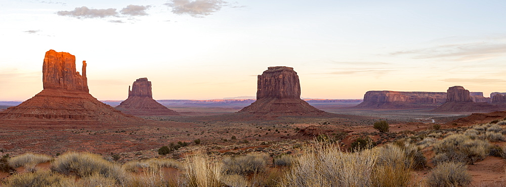 The giant sandstone buttes glowing pink at sunset in Monument Valley Navajo Tribal Park on the Arizona-Utah border, United States of America, North America - 1225-1201