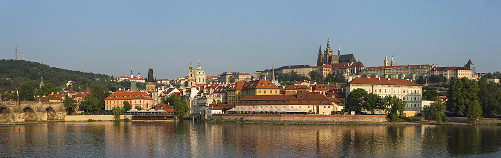 Panorama of Prague Castle (Hradčany), Mala Strana, and Charles Bridge lit by sunrise, Prague, Czech Republic