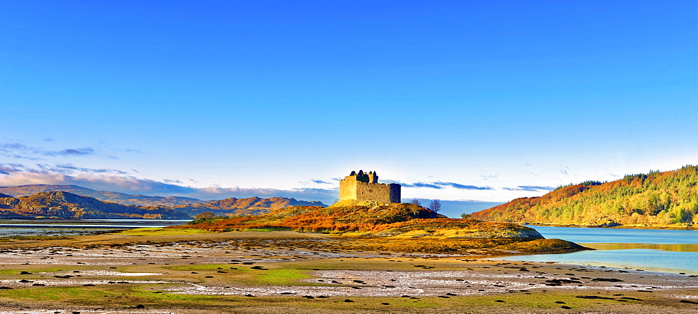 Castle Tioram on the coastal island Eilean Tioram where River Shiel and Loch Moidart meet, at low tide on a sunny winter morning - 1246-11