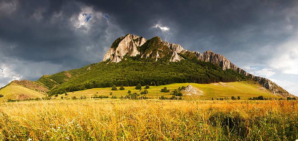 Panorama of Piatra Secuiului over Rimetea village in the Transcaului Mountains in western Transylvania, 25 km west of Turda, Romania, Europe