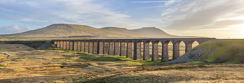 View to Ingleborough and the 24 arches of Ribblehead Viaduct on the Settle to Carlisle railway line, Yorkshire Dales, North Yorkshire, England, United Kingdom, Europe - 1266-172