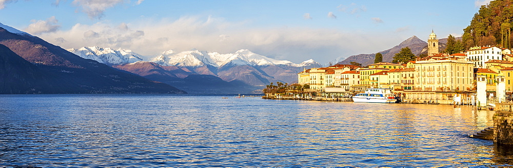 Panoramic view of Bellagio with snowcapped mountains in the background, Lake Como, Lombardy, Italian Lakes, Italy, Europe