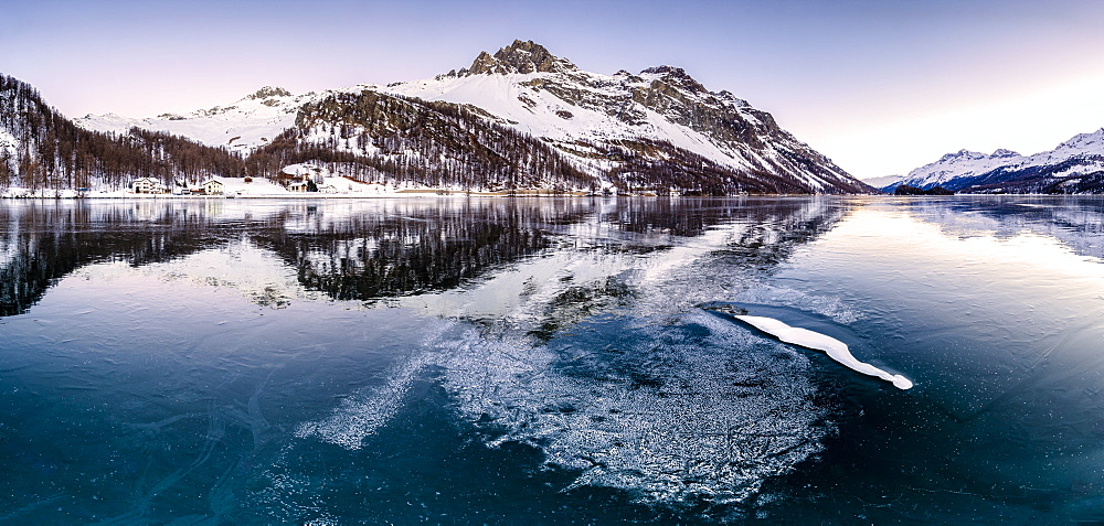Panoramic view of the icy surface of Lake Sils at sunrise, Engadine Valley, Graubunden, Swiss Alps, Switzerland, Europe
