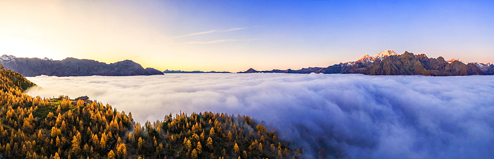 Aerial view of Malenco valley covered by fog at sunrise, Valmalenco, Valtelllina, Lombardy, Italy, Europe - 1269-650