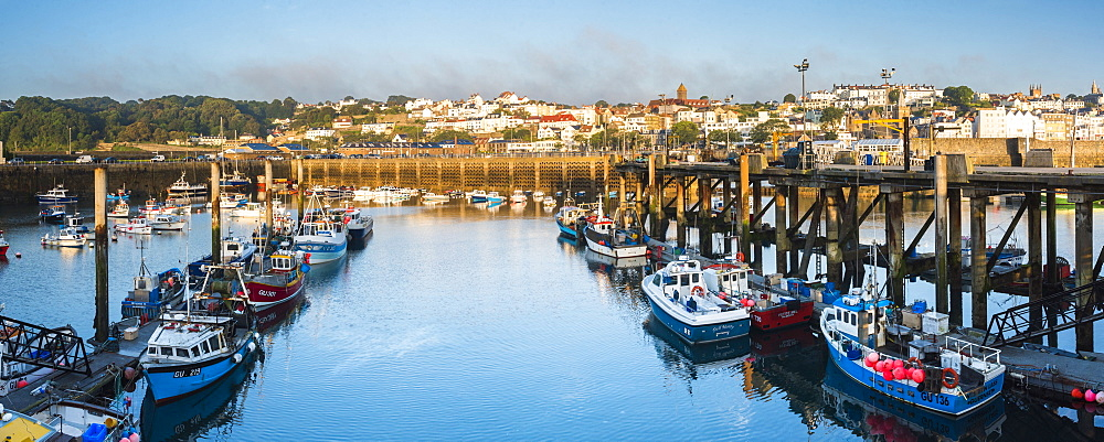 Boats in St. Peter Port Harbour at sunrise, Guernsey, Channel Islands, United Kingdom, Europe