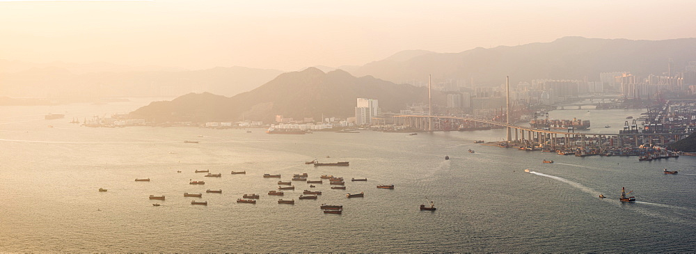 Boats in Victoria Harbour at sunset, seen from Victoria Peak, Hong Kong Island, Hong Kong, China, Asia - 1272-288
