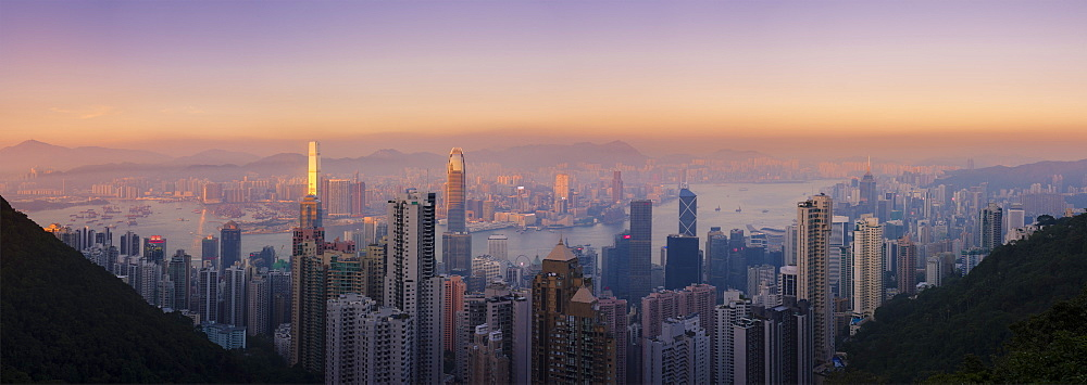 Hong Kong skyline at sunset, with a beautiful view of the Central CBD, Victoria Harbor, Kowloon cityscape