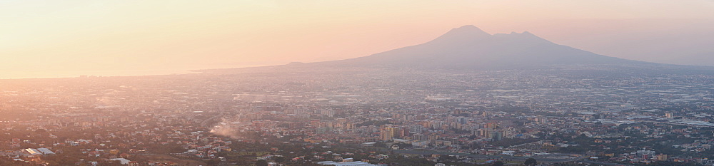 Panoramic view of the city of Naples and Mount Vesuvius at sunset, Campania, Italy, Europe