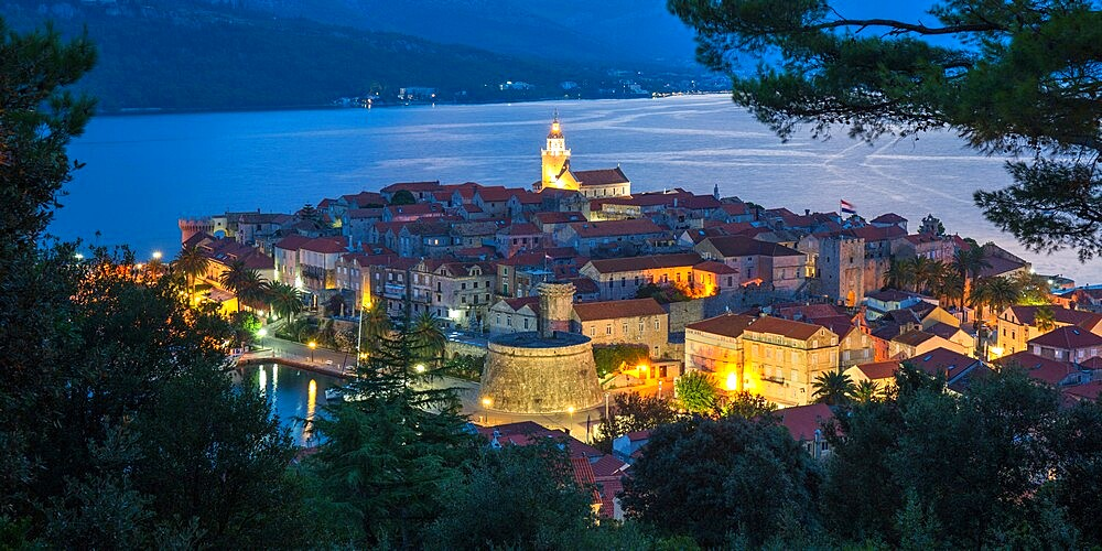 View over the Old Town at dusk, the illuminated cathedral prominent, Korcula Town, Korcula, Dubrovnik-Neretva, Dalmatia, Croatia