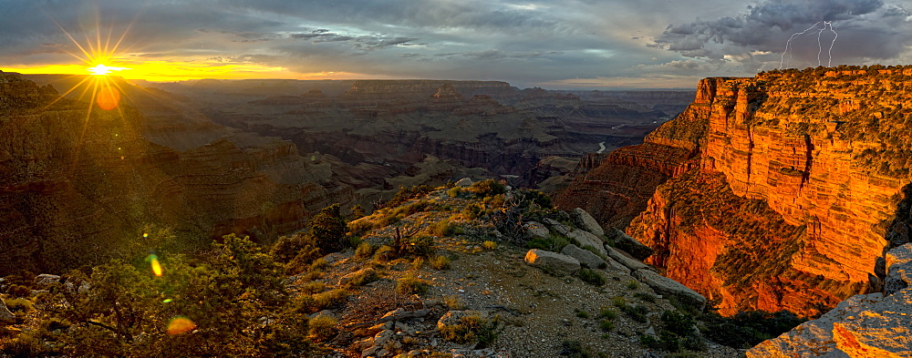 Grand Canyon Arizona viewed west of Moran Point at sunset with an approaching storm on the right.