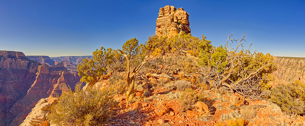 The rocky peak of the Sinking Ship rock formation in Grand Canyon National Park Arizona. This peak is called the Smoke Stack. - 1311-307
